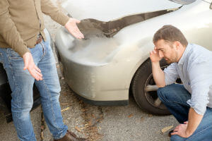 assessing the damage after a car accident