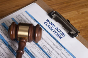 work injury claim form and a gavel