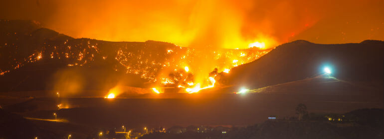 wildfire on the mountainside at night