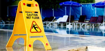 A sign warning people that the floor is wet, and therefore a hazard for slips, trips and falls.